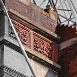 partially-demolished 1880's chicago presbyterian hospital building facade ornament awaiting rescue
