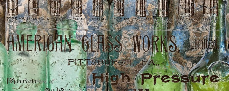 """pile of 19th century """"pictorial"""" hutchinson bottles discovered behind ace on ashland"""