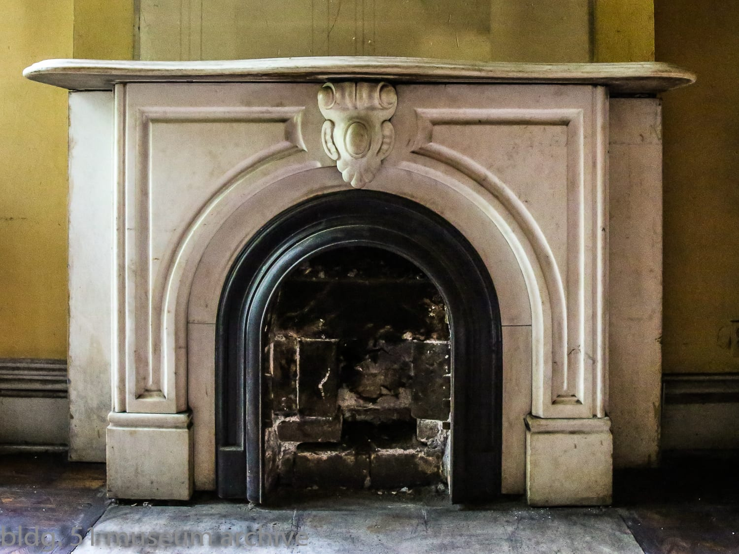 photographic study of post fire italianate row house interior