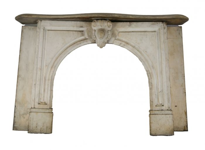 original early 1870's salvaged chicago interior residential white carrara  marble fireplace mantel with arch top opening and ornamental keystone