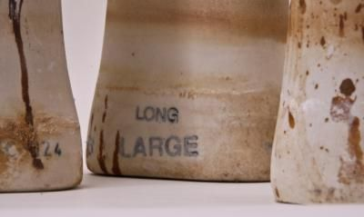 vintage industrial grade signed ceramic factory glove molds or forms